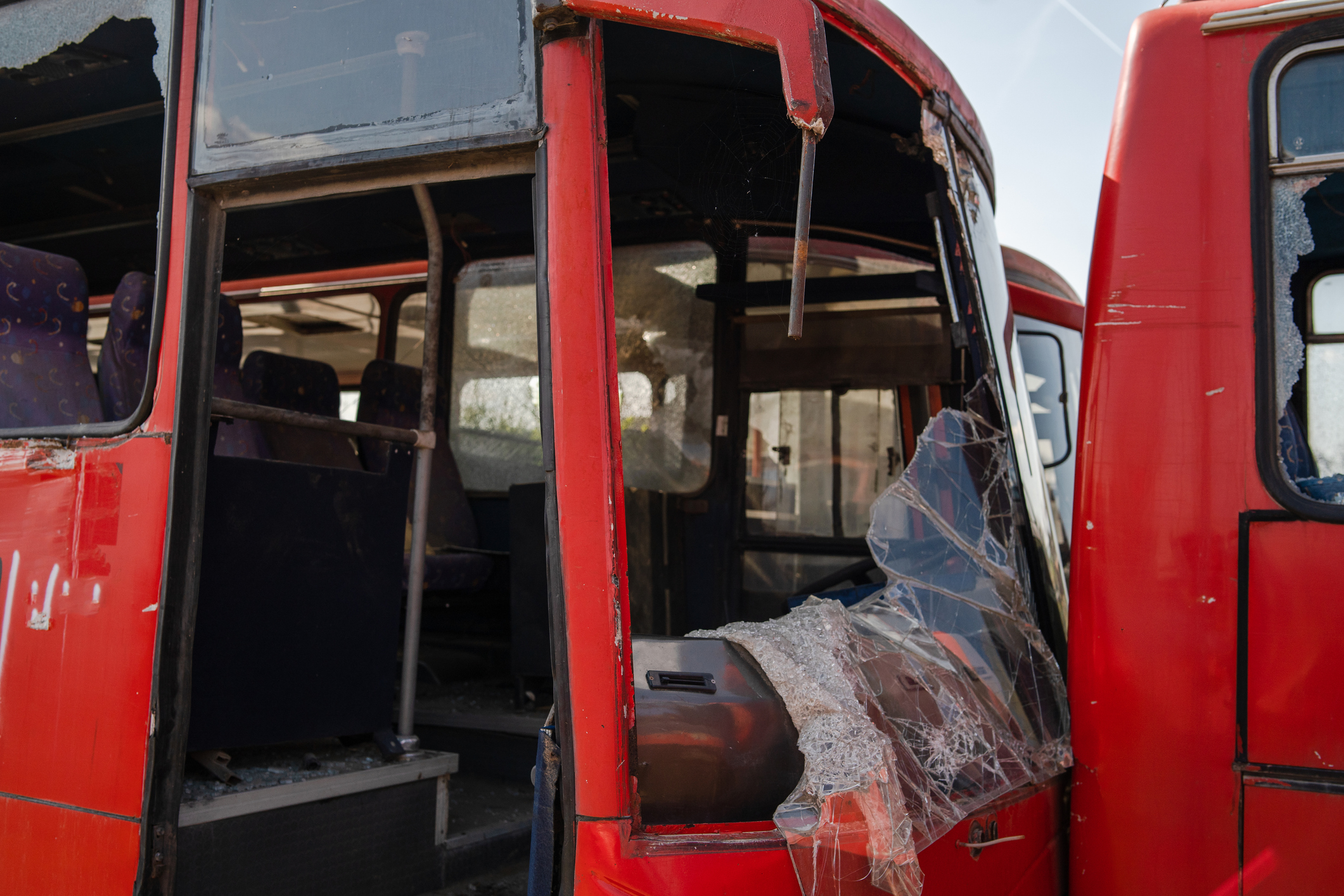 Bus collision crush traffic accident broken wrecked buses with smashed windshield shredded glass ready for scrap junk