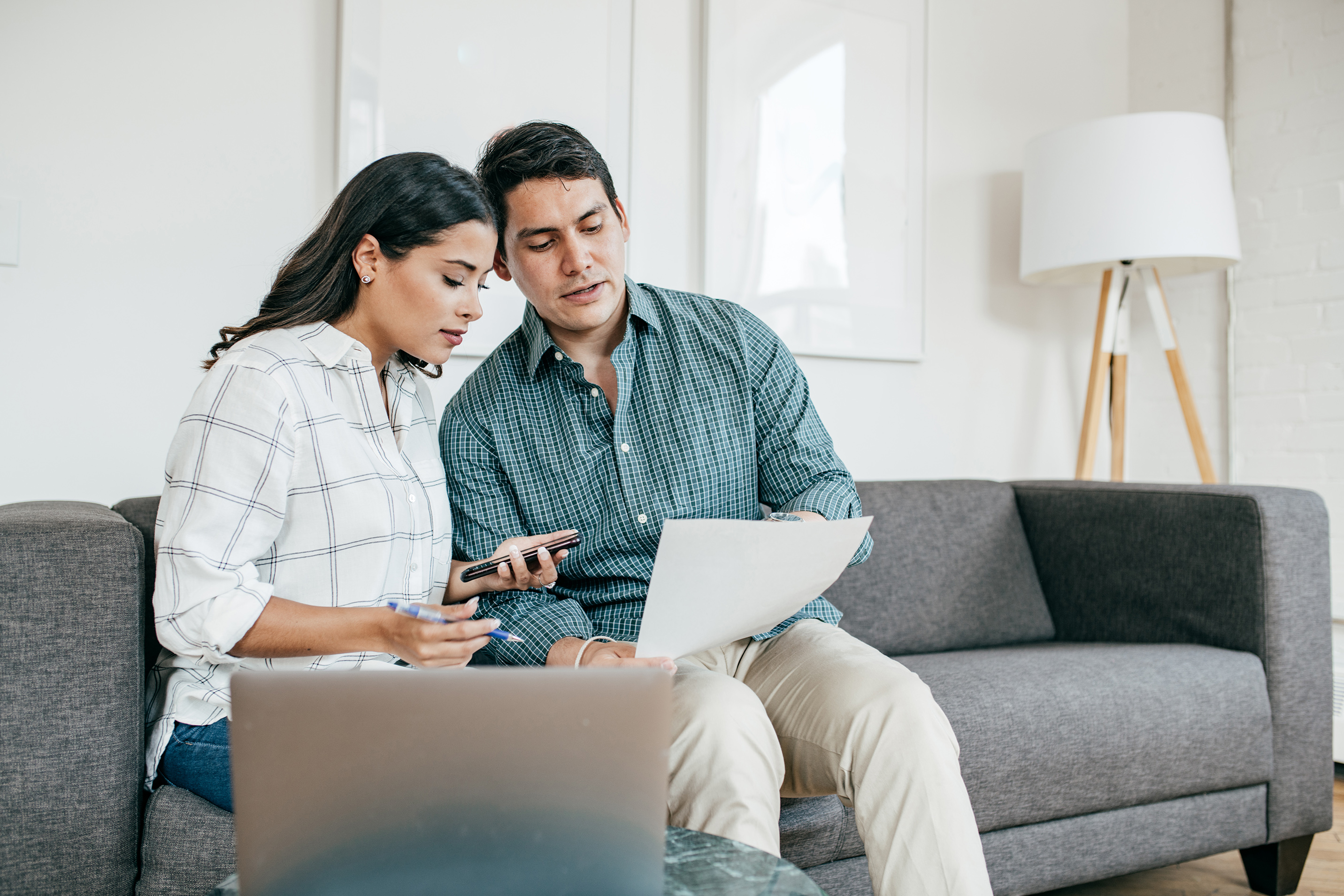 Couple looking on bank statements